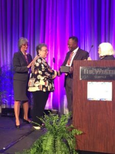 Margery Ganz is presented the Wollitzer Award at the 13th Annual Forum Conference in Seattle