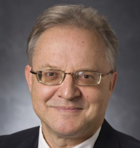 Markus Crepaz's professional headshot. A middle-aged man with grey hair and glasses, wearing a black suit jacket with a white shirt.