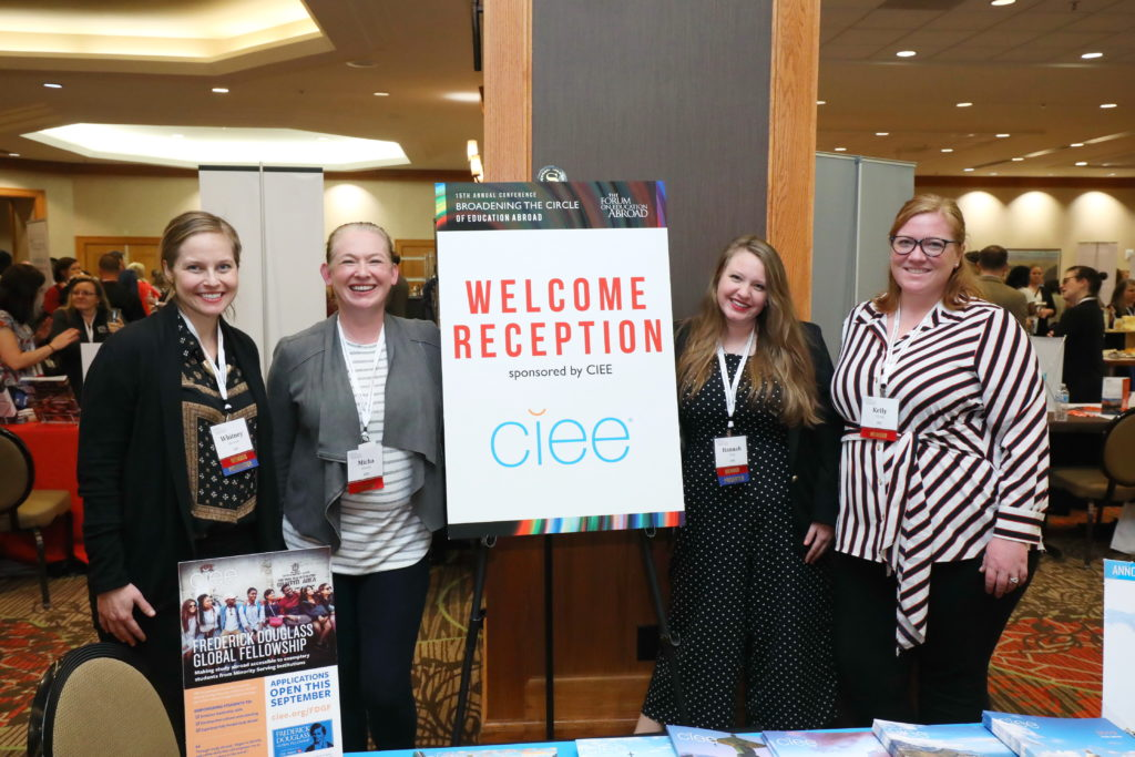 CIEE staff posing with Welcome Reception sign
