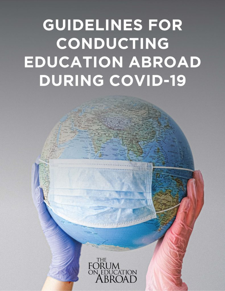 Cover of the Guidelines for Conducting Education Abroad during COVID-19. Gloved hands holding a globe over a gray background